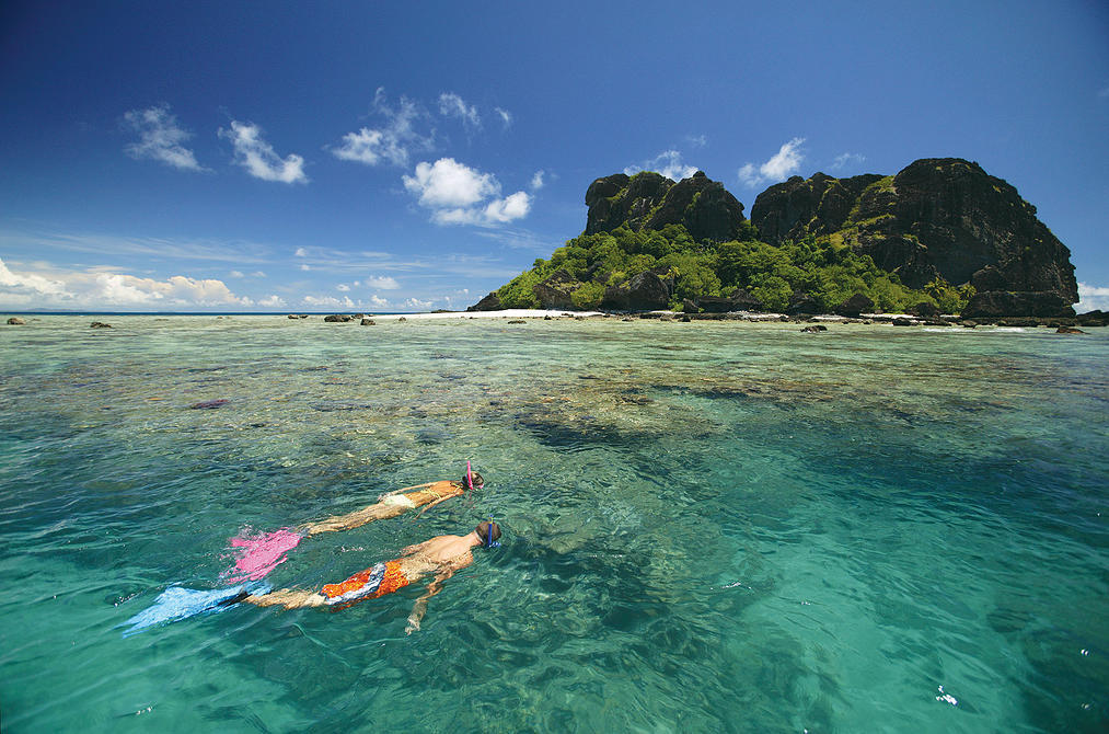 Snorkelling off the Spirit of the Pacific. Captain Cook Cruises, Fiji. Model released # 352 & 353